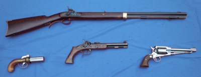 A variety of black powder muzzleloaders & black powder revolver.
